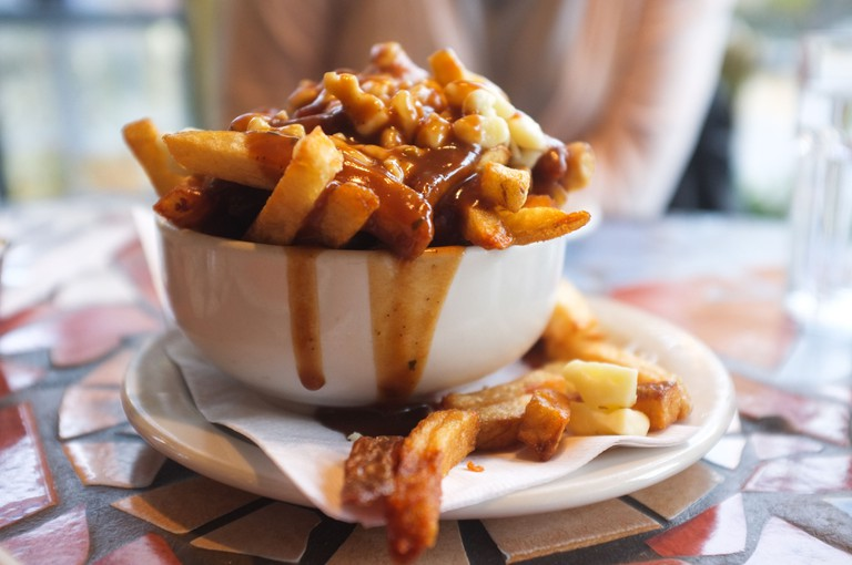 Poutine is a fast food that originated in Quebec, Canada