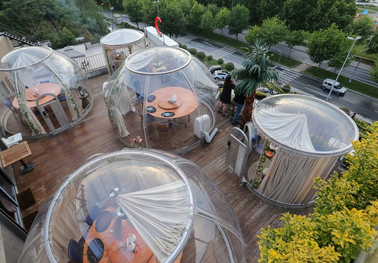 """Isolated eating areas in the shape of """"dome"""" as a measure against coronavirus (COVID-19) pandemic, are seen at a restaurant with Halic view in Istanbul, Turkey"""