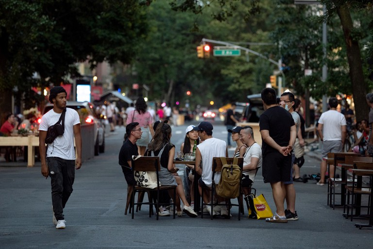 Re-opening ContinuesPeople without masks sit at a table on a closed-to-traffic St. Marks Place as the city moves into Phase 4 soon of re-opening following restrictions imposed to curb the coronavirus pandemic in New York City Across Densely Populated New York And New Jersey Areas
