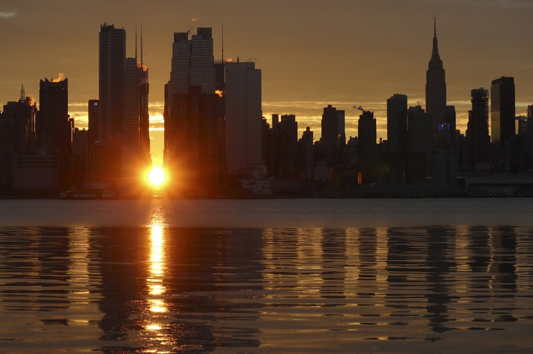 Manhattanhenge sunrise over the Hudson River in New York City