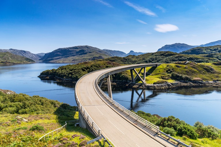 View of Kylesku Bridge on North Coast 500 tourist route in Sutherland, Highland, Scotland.