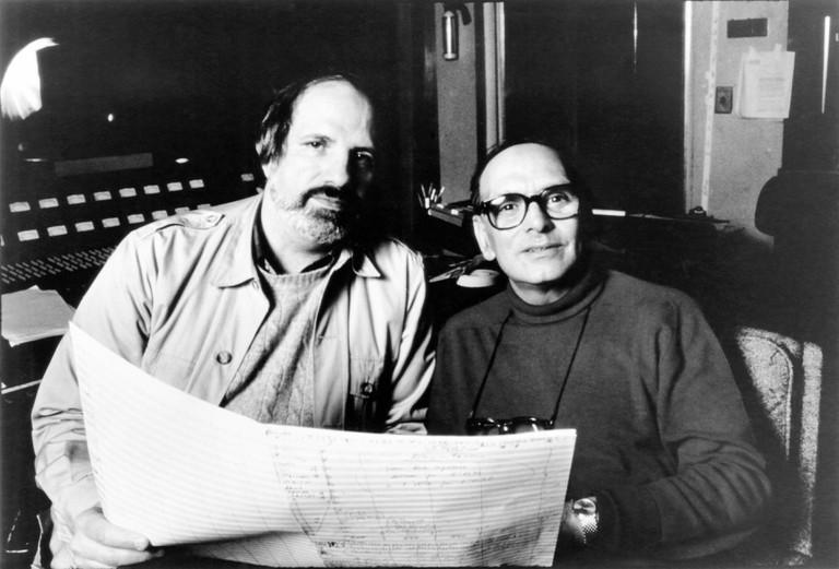 THE UNTOUCHABLES, from left: director Brian De Palma, composer Ennio Morricone, 1987. ©Paramount Pictures/courtesy Everett