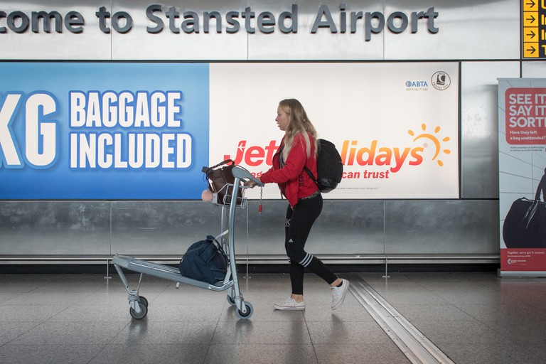Travellers at Stansted Airport , London