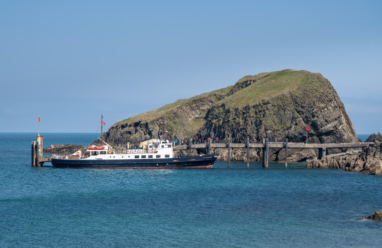 Tourists land from MS Oldenburg on Lundy Island in Devon
