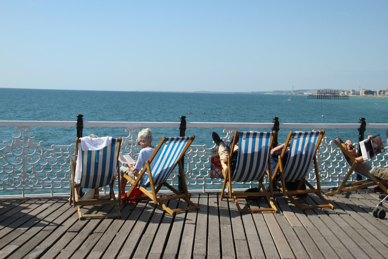 People bask in the sun on the Brighton Palace Pier on a sunny September afternoon