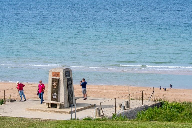 Tourists visiting the Fifth Engineer Special Brigade Memorial at Omaha Beach, Colleville-sur-Mer, Calvados
