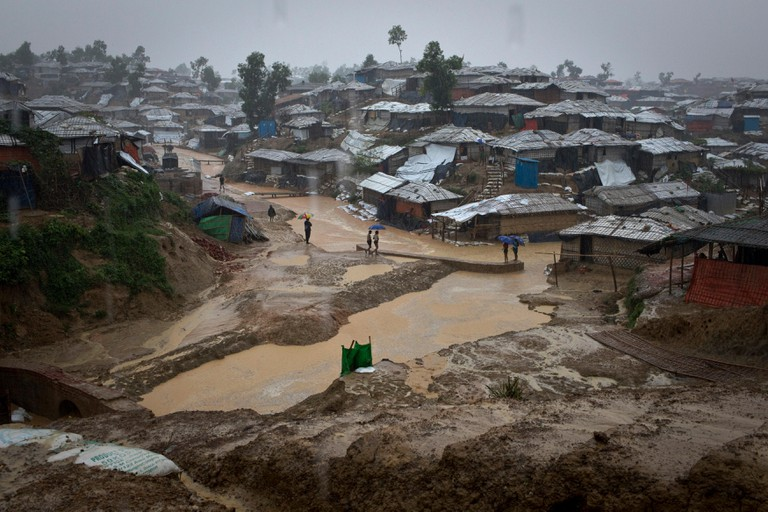Rohingya refugees shield from the rain in Balukhali, Camp 10, part of the mega refugee camp sheltering over 800,000 Rohingya refugees, Cox's Bazar, Ba