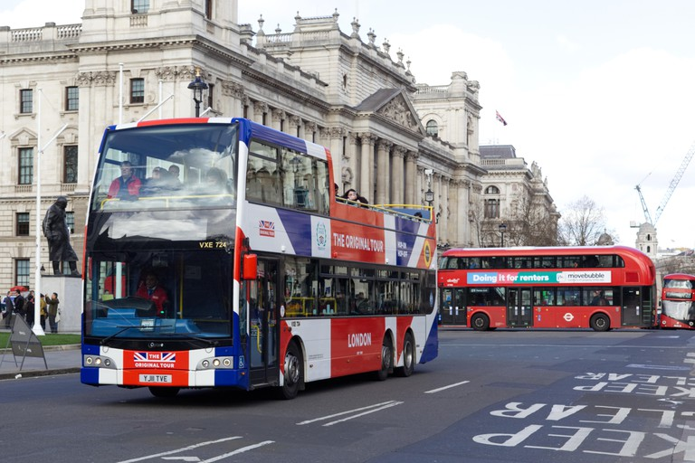 London Buses and London tour coach at parliament square
