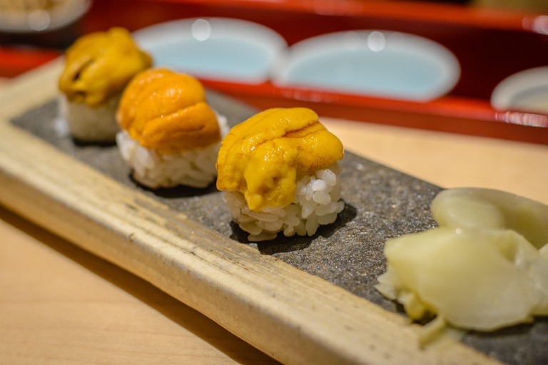 sea urchin uni sushi on rice with pickled ginger
