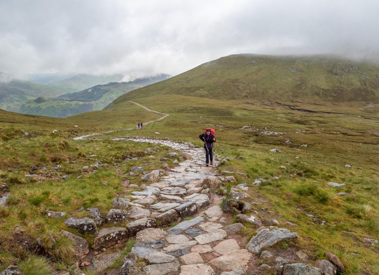 Walkers ascending the steep but well marked path to the summit of Ben Nevis