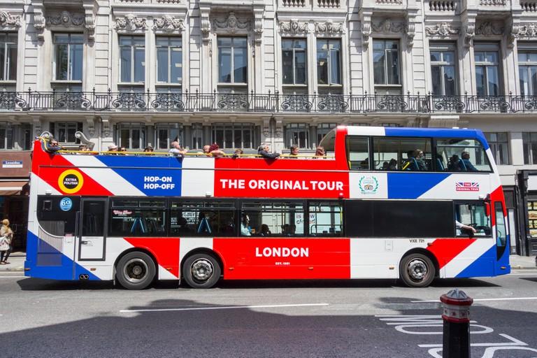 An Original Tour double-decker open-top bus on Fleet Street