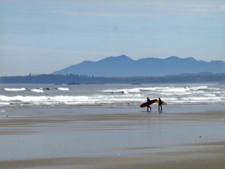 Surfers on Long Beach , British Columbia , Canada