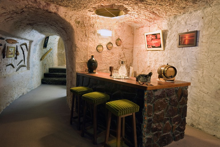 Australia, South Australia, Coober Pedy. Bar in Faye's underground home, built by 3 women in the 1960s using pick and shovel.