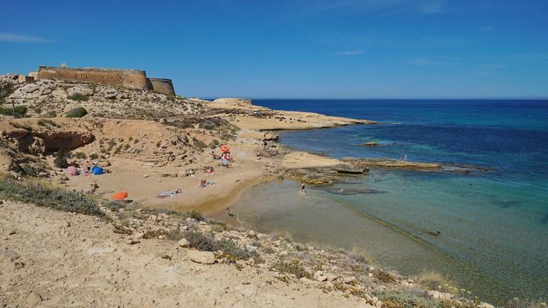 Cove in the Cabo de Gata-Nijar natural park with the castle of San Ramon, el Playazo de Rodalquilar, Mediterranean sea, Almeria, Andalusia, Spain