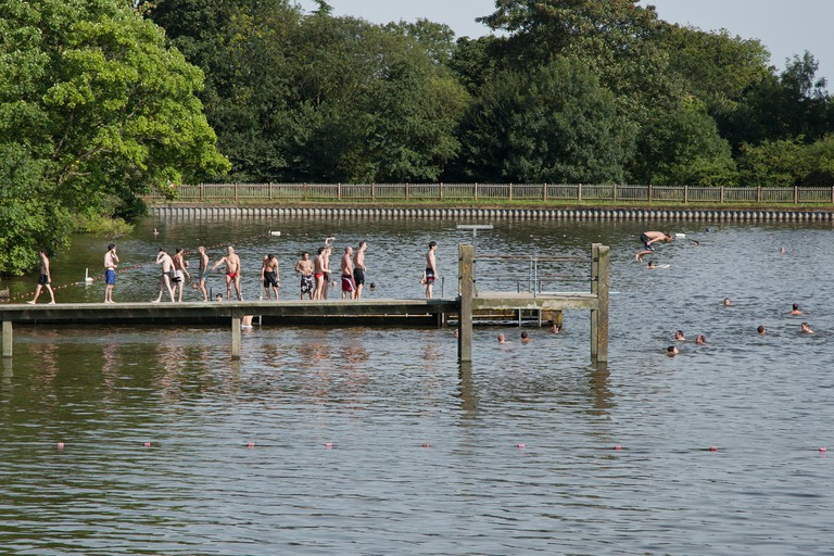 Enjoying a bath during the heatwave in one of the pond in Hampstead Heath, North London