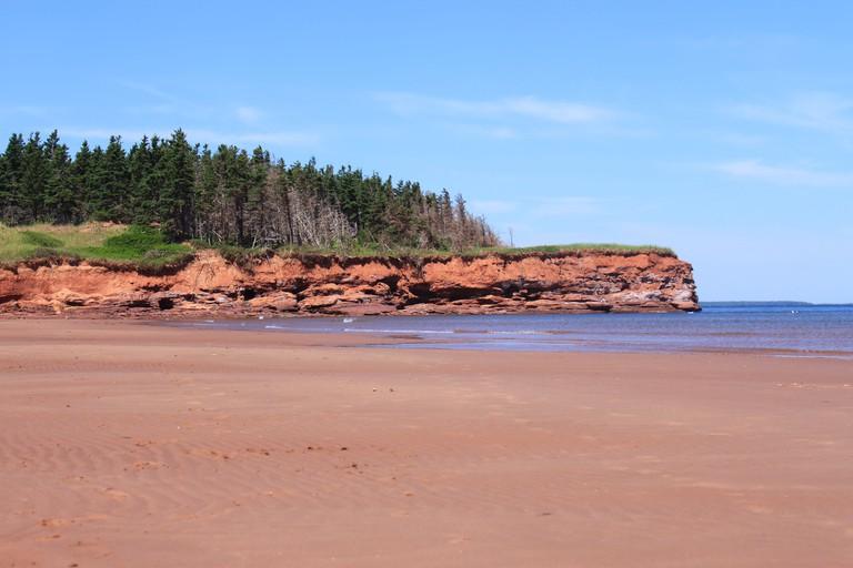 Red sand cliffs and beach at Cabot Beach, Prince Edward Island, Canada