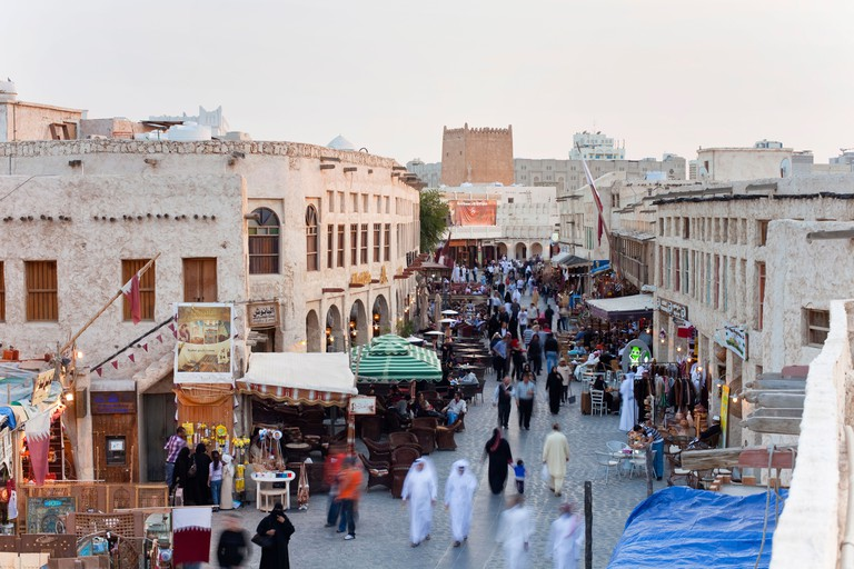 The restored Souq Waqif with mud rendered shops and exposed timber beams, Doha, Qatar, Middle East