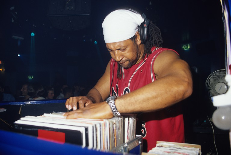 DJ Kool Herc, looking through his records whilst DJing, 2000