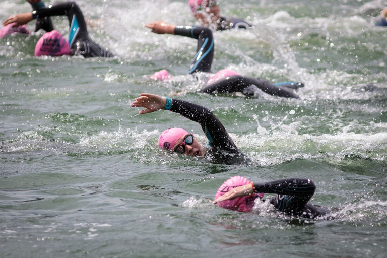 Competitors take part in the swim at Royal Victoria Docks