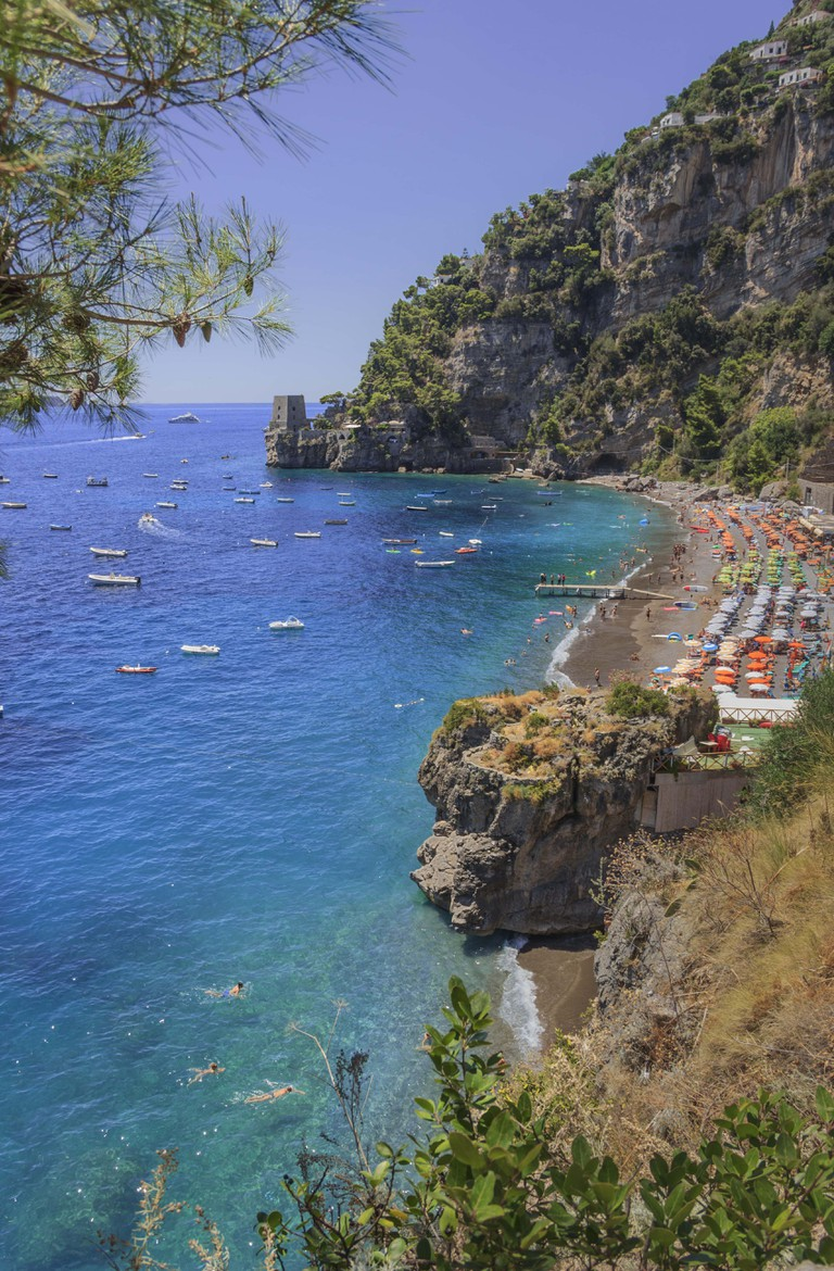 Summertime sescape: Amalfi Coast (Costiera Amalfitana).The best beaches in Italy:Positano seaside (Campania).Fornillo beach set in the cliff: the background a watchtower.