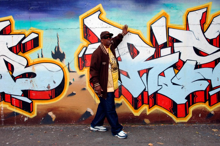 Rapper Grandmaster Caz conducts a Hip Hop tour with a stop at the Graffiti Wall of Fame on East 106 St in East Harlem