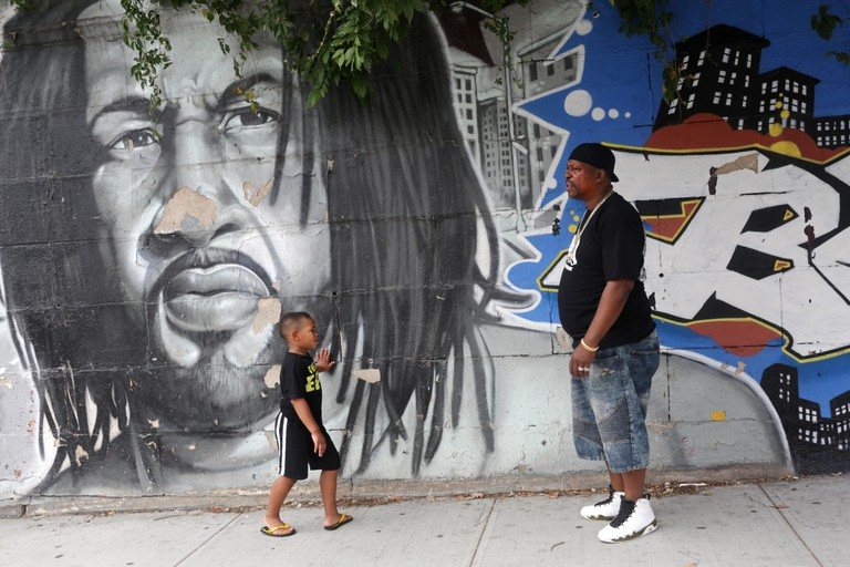 "BRONX, NY - AUGUST 31: Curtis ""Grandmaster Caz"" Brown, an icon of early hip hop, and his grandson, Isiah Watson, 5, lead a Hush Hip Hop bus and walking tour across the Bronx, NY, on August 31, 2016."
