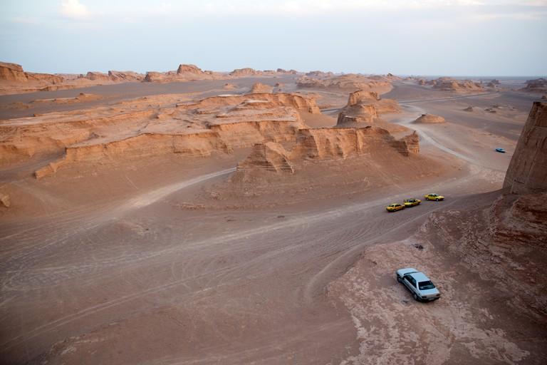 Cars parked at Dasht-e Lut desert, Kerman province, Iran