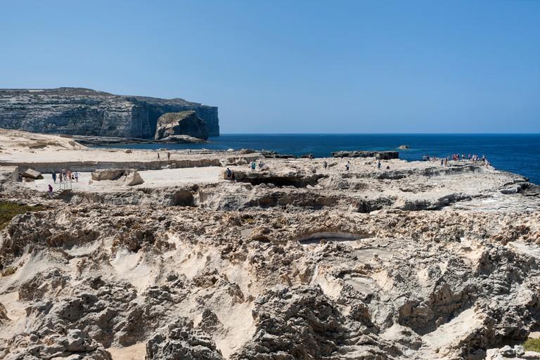 Coastal scenery near Dwejra Bay on the island of Gozo in Malta. It was the setting for the Dothraki wedding scene in Game of Thrones.