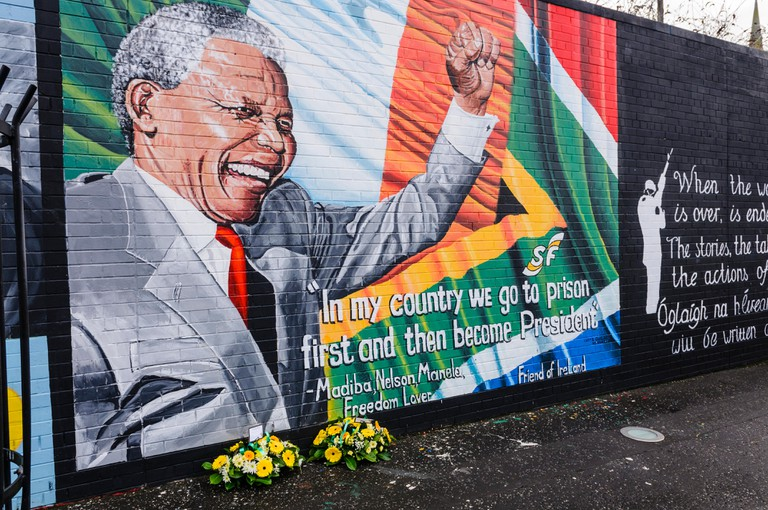 Belfast, Northern Ireland. 7th Dec 2013 - Floral tributes left at Mandela Mural following the death of Nelson Mandela on the 5th December. Credit:  Stephen Barnes/Alamy Live News