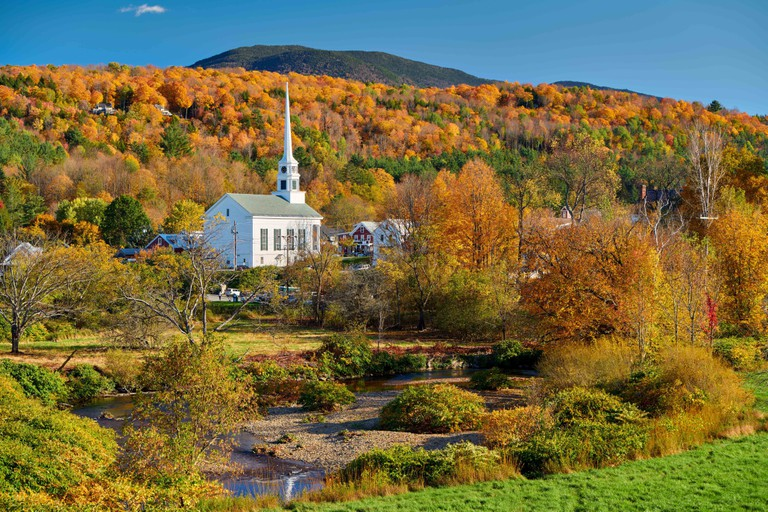 Iconic New England church in Stowe town at autumn. Image shot 11/2019. Exact date unknown.
