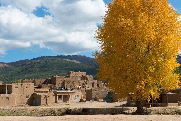 Trees with fall colors at the Taos Pueblo which is the only living Native American community designated both a World Heritage Site by UNESCO and a Nat