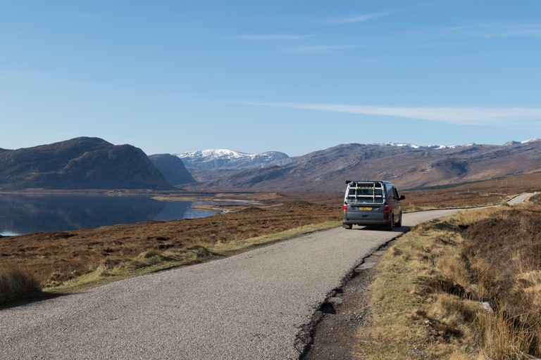 Minibus on North Coast 500 route in sutherland. Image shot 04/2018. Exact date unknown.