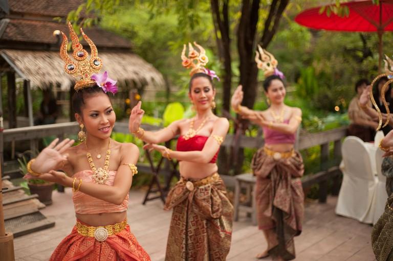 Thai women dancing in traditional dress at Siam Niramit, Bangkok, Thailand, Asia