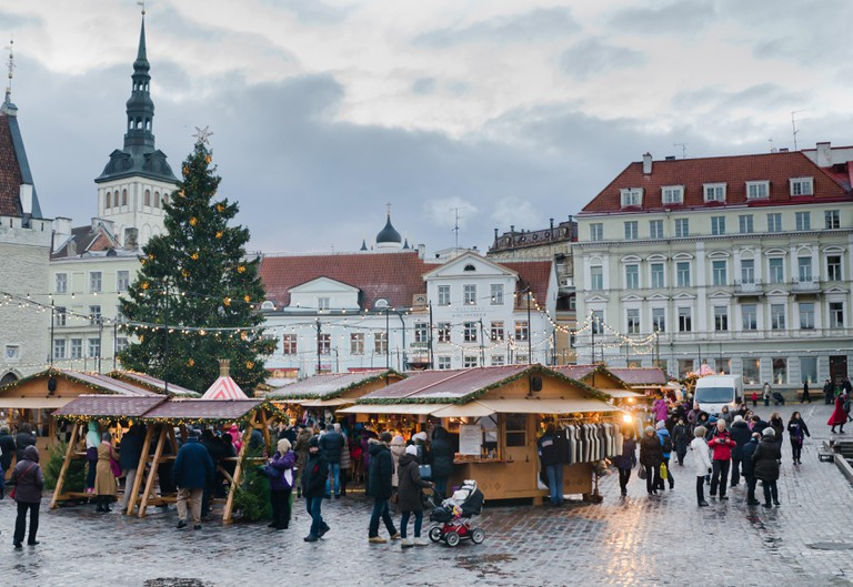 TALLINN, ESTONIA ? DECEMBER 01: People enjoy Christmas market in Tallinn on December 01, 2013 in Tallinn , Estonia. It is Estonia oldest Christmas Market with a very long history dating back to 1441.