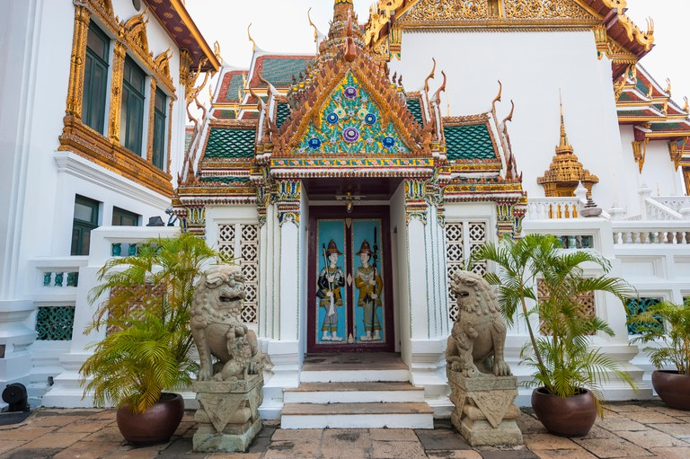 Door with a relief of ancient guards, Grand Palace, Bangkok, Thailand