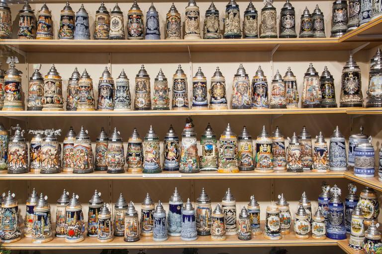 Germany, Bavaria, Munich, Souvenir Shop Window Display of Beer Steins