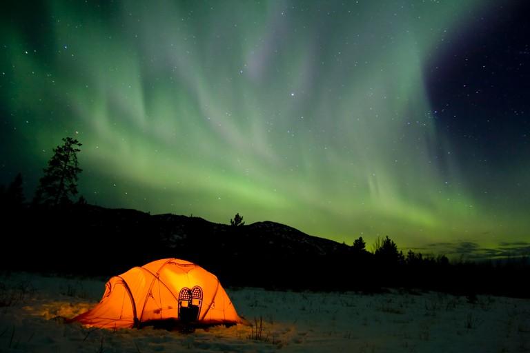 northern lights, aurora borealis, tent, snow shoes, Yukon Territory, Canada