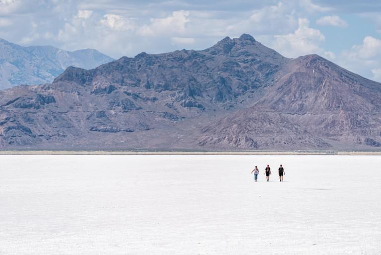 Wendover, USA - July 27, 2019: View of White Bonneville Salt Flats near Salt Lake City, Utah during day with people walking