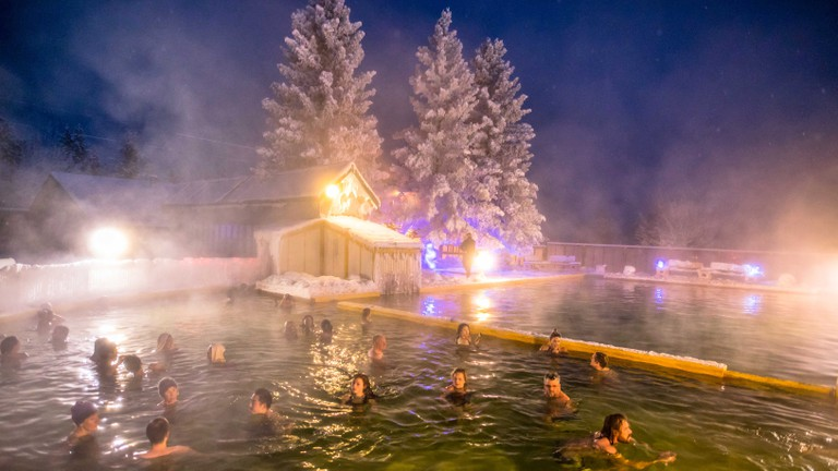 Take a dip in a local hot spring to warm up after a day of exploring in the snow