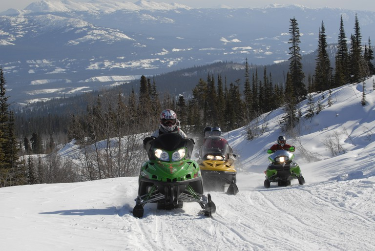 Add some adrenaline to your schedule by hopping on a snowmobile and whizzing through the snow