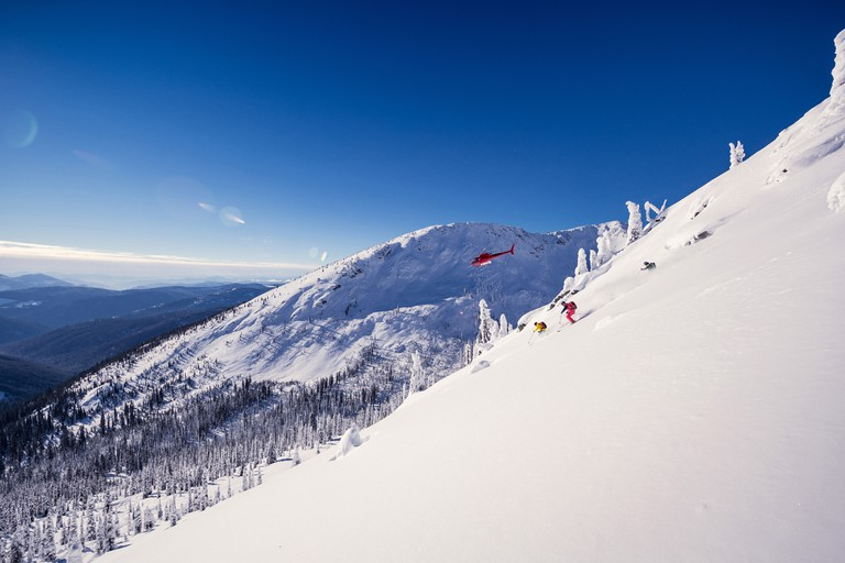 Take a helicopter ride to the top of a mountain before making your way straight back down on snowboard or skis