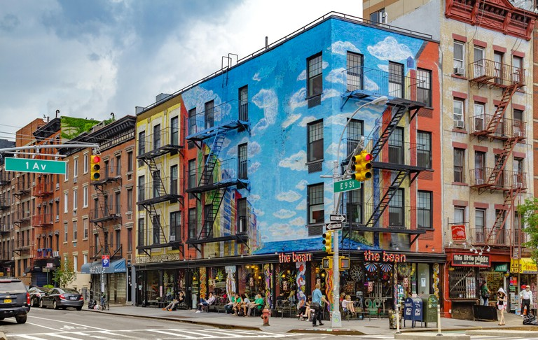 The Bean Coffee shop located in a colourful painted building in the East Village at the junction of 1st and 9th , Manhattan . New York City ,USA