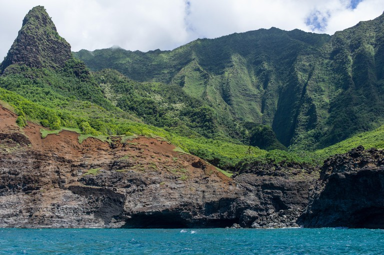 The rugged volcanic Na Pali Coast State Park on the north shore of Kauai, Hawaii, United States, is accesible only by boat or on foot.