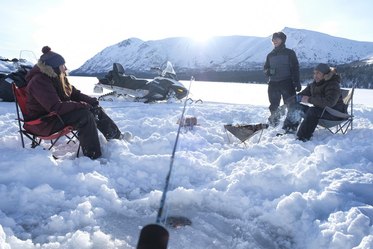 Ice fishing is a must on a winter trip to Yukon