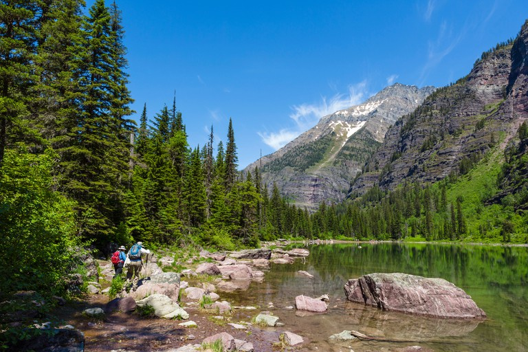 Hikers on the shore of Avalanche Lake, Glacier National Park, Montana