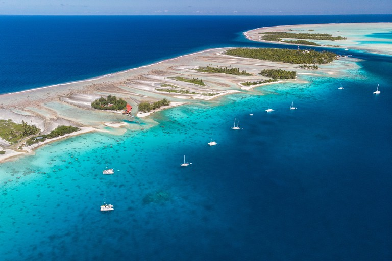 Sailing with catamaran in Tuamotu Archipelago french Polynesia - Aerial view of the lagoon by drone