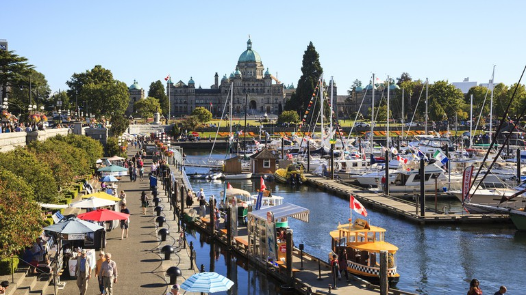 Enjoy a relaxed stroll on the boardwalk around the Inner Harbour of BC's capital city of Victoria