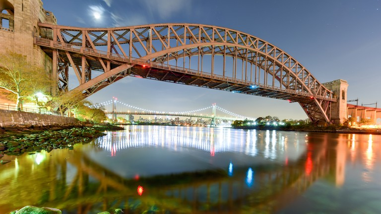Hell Gate Bridge and Triboro Bridge at night, in Astoria, Queens, New York
