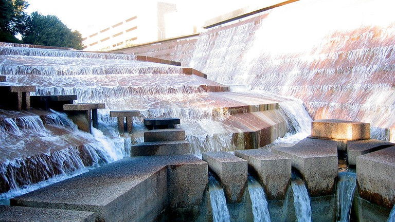 Water cascades down terraced steps at the Fort Worth Water Gardens