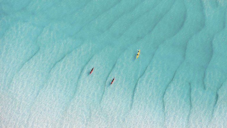 Kayaking at Whitehaven Beach, Whitsundays Islands, QLD | Courtesy of Tourism Whitsundays © Phill Gordon